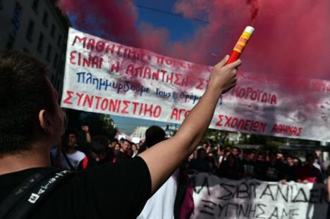 People held placards during a massive demonstration as part of a 24-hour general strike in Athens Thursday. Around 20,000 people demonstrated against fresh cuts in Athens, with sporadic outbreaks of violence. AFP/Getty Images